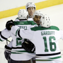Dallas Stars left wing Antoine Roussel (21), of France, celebrates with teammates, including Ryan Garbutt (16), after scoring against the Nashville Predators in the first period of an NHL hockey game Saturday, Oct. 11, 2014, in Nashville, Tenn The Associa