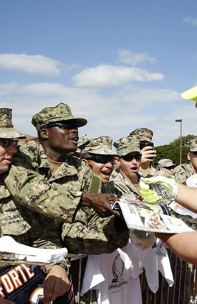 Houston Texans defensive end J.J. Watt (99) signs autographs for service members during an NFL Pro Bowl practice on Earhart Field at Joint Base Pearl Harbor-Hickam sponsored by the USAA the official military sponsor of the NFL on Thursday January 23, 2014 in Honolulu, Hawaii. (Aaron M. Sprecher/AP Images for USAA)