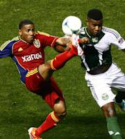 Real Salt Lake forward Jou Plata, left, and Portland Timbers Rauwshan McKenzie (31) go for the ball during the first half of a soccer game at Rio Tinto Stadium, Friday, Aug. 30, 2013, in Sandy, Utah. (AP Photo/The Salt Lake Tribune, Chris Detrick)