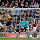 Burnley's Ashley Barnes, second left, scores a header during their English Premier League soccer match against Hull City at Turf Moor, Burnley, England, Saturday, Nov. 8, 2014