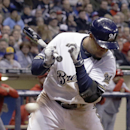 Milwaukee Brewers' Carlos Gomez is hit by a pitch during the eighth inning of a baseball game against the St. Louis Cardinals Tuesday, April 15, 2014, in Milwaukee The Associated Press