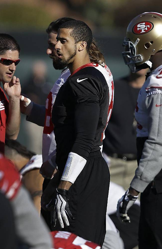 San Francisco 49ers quarterback Colin Kaepernick, center, prepares for an NFL football practice in Santa Clara, Calif., Friday, Jan. 17, 2014. The 49ers are scheduled to play the Seattle Seahawks for the NFC championship on Sunday