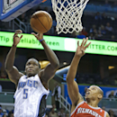 Orlando Magic's Victor Oladipo (5) shoots over Milwaukee Bucks' Caron Butler (3) during the first half of an NBA basketball game in Orlando, Fla., Wednesday, Nov. 13, 2013 The Associated Press