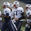 New England Patriots tight end Rob Gronkowski, center, warms up on the field with teammates during an NFL football training camp practice at Gillette Stadium, Sunday, July 27, 2014, in Foxborough, Mass The Associated Press