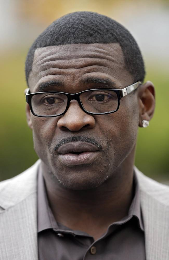 Hall of Fame receiver Michael Irvin talks to reporters during the Cleveland Browns practice at the NFL football team's facility in Berea, Ohio Wednesday, Nov. 6, 2013. Irvin spoke to Browns' players before practice about the commitment it takes to win a Super Bowl