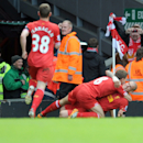 Liverpool's Martin Skrtel right, celebrates with team-mate Steven Gerrard after he scores the second goal of the game for his side during their English Premier League soccer match against Manchester City at Anfield in Liverpool, England, Sunday April. 13,