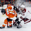 Philadelphia Flyers' Michale Del Zotto (15), left, and Arizona Coyotes' Shane Doan (19), right, pursue the puck near the Coyotes' goal in the overtime period of an NHL hockey game, Tuesday, Jan. 27, 2015, in Philadelphia. The Flyers won 4-3 The Associated