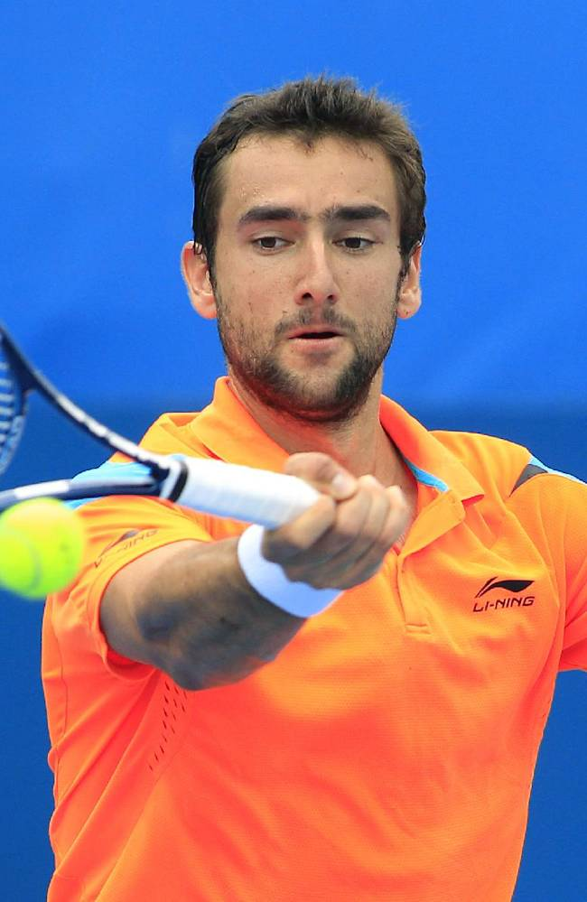 Marin Cilic of Croatia hits a forehand to Jan-Lennard Struff of Germany during their men's singles match at the Sydney International tennis tournament in Sydney, Australia, Tuesday, Jan. 7, 2014