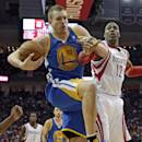 Houston Rockets' Dwight Howard (12) reaches for rebound with Golden State Warriors' David Lee (10) during the third quarter of an NBA basketball game Friday, Dec. 6, 2013, in Houston. The Rockets won 105-83. (AP Photo/David J. Phillip)