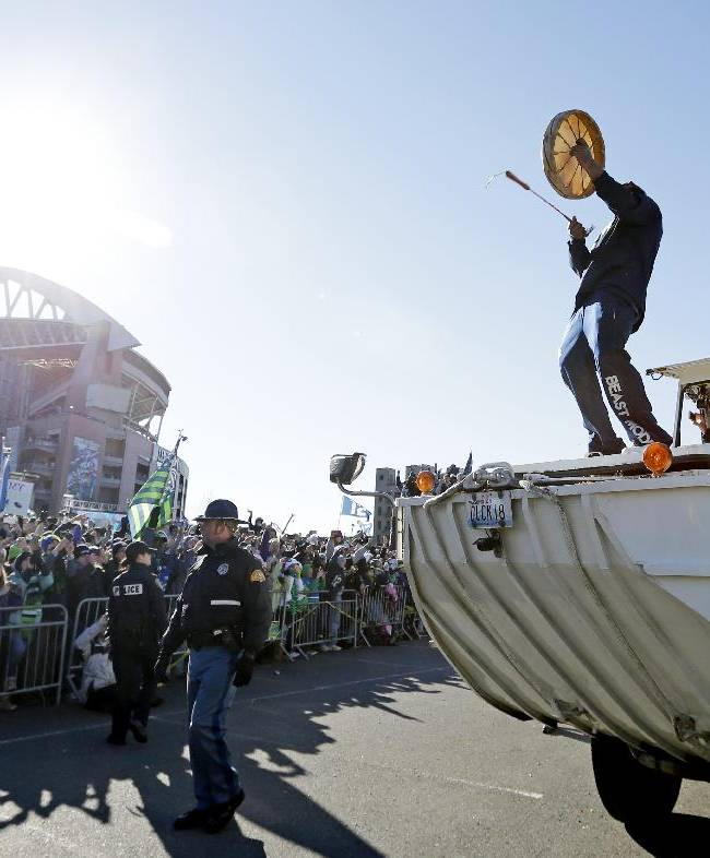 Seattle Seahawks' Marshawn Lynch beats on a Native American drum as he rides atop a duck boat heading toward CenturyLink Field at a parade for NFL football's Super Bowl XLVIII champions on Wednesday, Feb. 5, 2014, in Seattle. The Seahawks defeated the Denver Broncos on Sunday