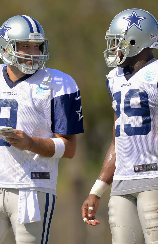 Romo skips full-pad session for 1st time at camp
