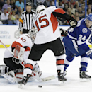 Tampa Bay Lightning right wing Ryan Callahan (24) tries to get a backhander past Ottawa Senators goalie Robin Lehner (40) and center Zack Smith (15) during the second period of an NHL hockey game Monday, March 24, 2014, in Tampa, Fla The Associated Press