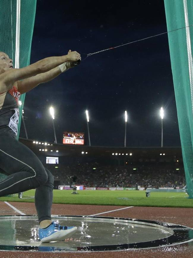 Germany's Kathrin Klaas makes an attempt in the women's hammer throw final during the European Athletics Championships in Zurich, Switzerland, Friday, Aug. 15, 2014