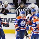 Edmonton Oilers Martin Marincin (85), Jordan Eberle (14), Taylor Hall (4) and Ryan Nugent-Hopkins (93) celebrate an empty net goal against the Anaheim Ducks during third period NHL hockey action in Edmonton, Alberta, on Sunday April 6, 2014 The Associate