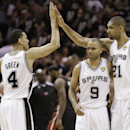 San Antonio Spurs' Danny Green (4), Tony Parker (9) and Tim Duncan (21) react against the Miami Heat during the second half at Game 5 of the NBA Finals basketball series, Sunday, June 16, 2013, in San Antonio. (AP Photo/Eric Gay)