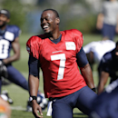 Seattle Seahawks quarterback Tarvaris Jackson smiles while stretching at an NFL football camp practice Sunday, July 27, 2014, in Renton, Wash The Associated Press