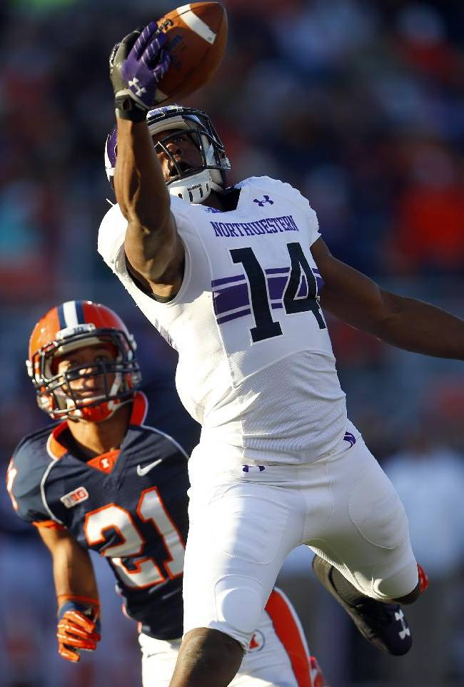 Northwestern wide receiver Christian Jones (14) catches a touchdown pass in front of Illinois defensive back Zane Petty (21) during the first half of an NCAA college football game on Saturday, Nov. 30, 2013, in Champaign, Ill