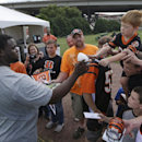 Cincinnati Bengals defensive tackle Geno Atkins, left, signs autographs after the NFL football team's first practice at training camp, Thursday, July 24, 2014, in Cincinnati. (AP Photo) The Associated Press