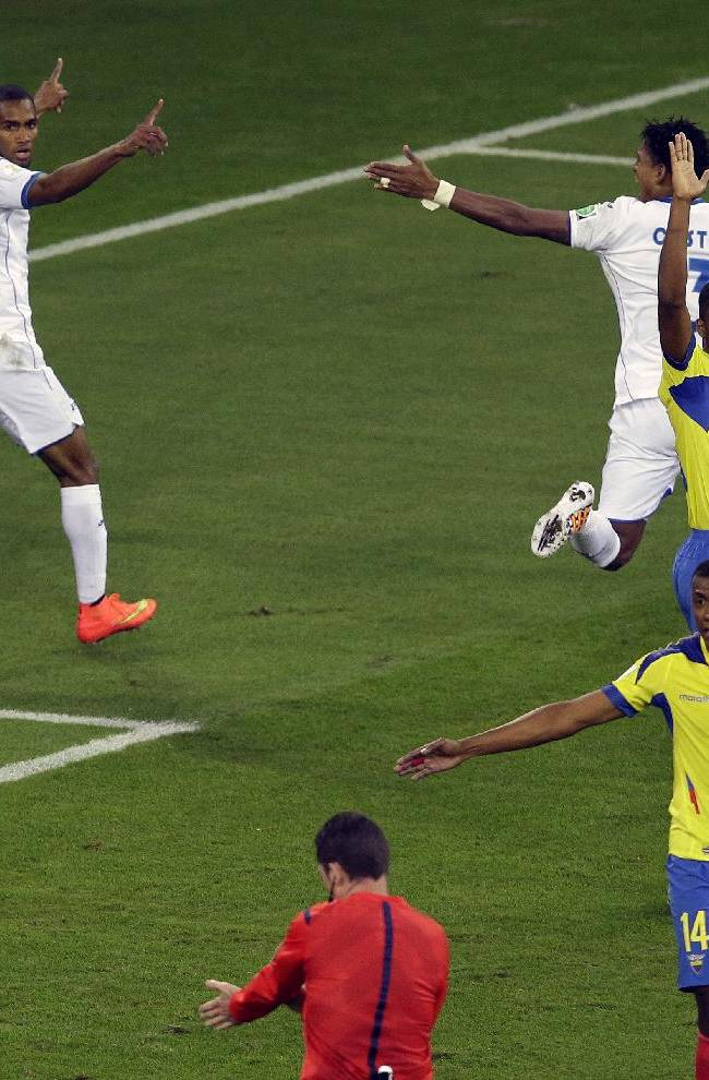 Honduras' Jerry Bengtson, left, looks to referee Benjamin Williams from Australia after scoring a disallowed goal during the group E World Cup soccer match between Honduras and Ecuador at the Arena da Baixada in Curitiba, Brazil, Friday, June 20, 2014