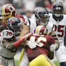 Washington Redskins' Alfred Morris (46) is stopped by Houston Texans' D.J. Swearinger (36) and J.J. Watt (99) during the first quarter of an NFL football game Sunday, Sept. 7, 2014, in Houston The Associated Press