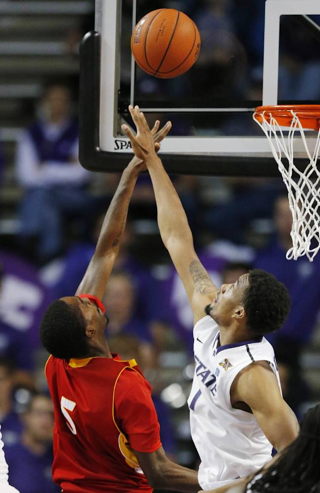 Pittsburg State guard Devon Branch (5) shoots over Kansas State guard Shane Southwell (1) during the second half of an exhibition NCAA college basketball game in Manhattan, Kan., Friday, Nov. 1, 2013