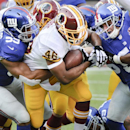 Washington Redskins running back Alfred Morris (46) is tackled by =New York Giants outside linebacker Devon Kennard (59) and New York Giants outside linebacker Mark Herzlich (58) during the second quarter of an NFL football game, Sunday, Dec. 14, 2014, in