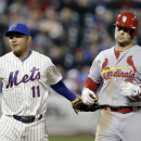 New York Mets' Ruben Tejada (11) tags out St. Louis Cardinals' Matt Holliday (7) during the ninth inning of a baseball game Tuesday, April 22, 2014, in New York The Associated Press