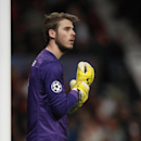 Manchester United's goalkeeper David de Gea adjust his gloves as he watches his team play during their Champions League group A soccer match between Manchester United and Shakhtar Donetsk at Old Trafford Stadium, Manchester, England, Tuesday, Dec. 10, 201