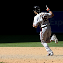San Francisco Giants' Angel Pagan (16) rounds the bases after hitting a three-run home run against the Arizona Diamondbacks during the eighth inning of a baseball game Thursday, April 3, 2014, in Phoenix The Associated Press