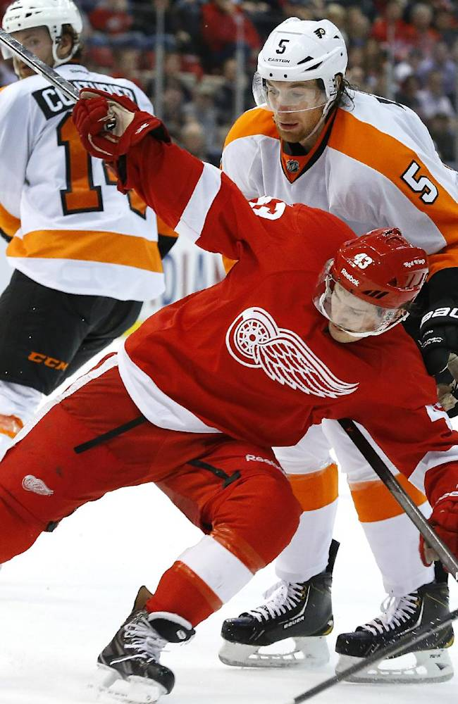Detroit Red Wings center Darren Helm (43) is held by Philadelphia Flyers defenseman Braydon Coburn (5) in the second period of an NHL hockey game in Detroit, Wednesday, Dec. 4, 2013