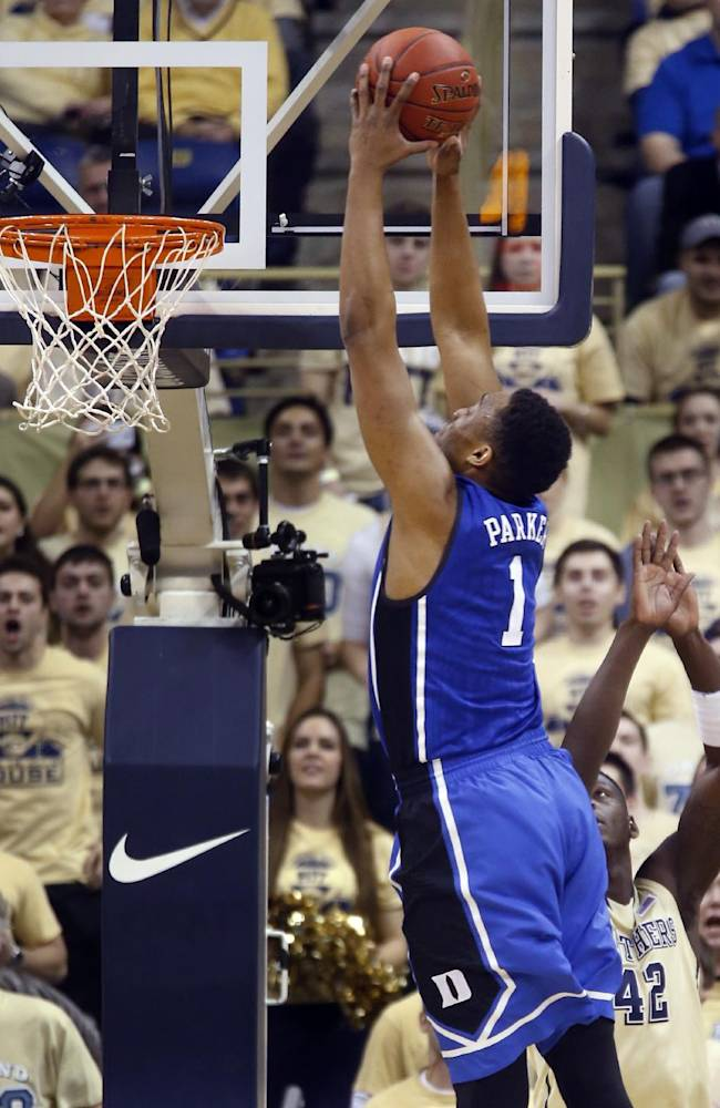 Duke's Jabari Parker (1) goes over Pittsburgh's Talib Zanna (42) for a dunk during the first half of an NCAA college basketball game on Monday, Jan. 27, 2014, in Pittsburgh