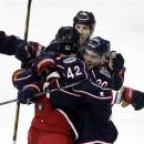 FILE - In this March 3, 2013 file photo, Columbus Blue Jackets' Artem Anisimov of Russia (42), Tim Erixon (20) and R.J. Umberger (18) celebrate Anisimov's goal against the Colorado Avalanche in an overtime period in an NHL hockey game in Columbus, Ohio. In the wake of a stirring 2013 second-half playoff run that fell just short, the Blue Jackets are seeing an upsurge in interest from fans. Ticket sales have increased, both among longtime buyers and new ones. (AP Photo/Paul Vernon, File)