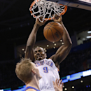 Oklahoma City Thunder forward Serge Ibaka (9) dunks in front of Detroit Pistons guard Kyle Singler (25) during the fourth quarter of an NBA basketball game in Oklahoma City, Wednesday, April 16, 2014. Oklahoma City won 112-111 The Associated Press