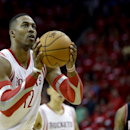 Houston Rockets' Dwight Howard (12) shoots a free throw against the Portland Trail Blazers during overtime in Game 1 of an opening-round NBA basketball playoff series Sunday, April 20, 2014, in Houston. The Trail Blazers won 122-120 in overtime. Howard mi