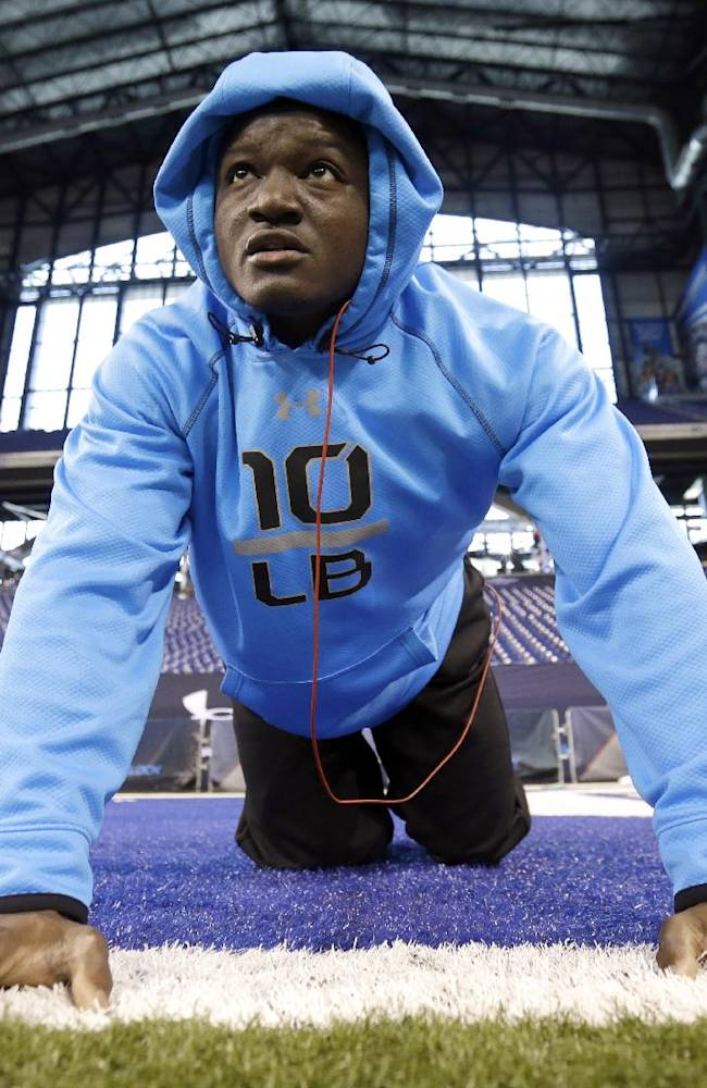 Iowa State linebacker Jeremiah George stretches on the field at the NFL football scouting combine in Indianapolis, Monday, Feb. 24, 2014
