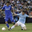 Manchester City midfielder James Milner, right, makes a tackle against Chelsea defender Paulo Ferreira during the second half of an exhibition international friendly soccer match, Saturday, May 25, 2013, at Yankee Stadium in New York. Manchester City won 5-3. (AP Photo/Julio Cortez)