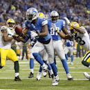 Detroit Lions wide receiver Calvin Johnson (81) runs into the end zone for a 20-yard touchdown run during the third quarter of an NFL football game against the Green Bay Packers at Ford Field in Detroit, Thursday, Nov. 28, 2013 The Associated Press
