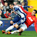 Manchester United's Robin van Persie tackles West Brom's Morgan Amalfitano during the English Premier League soccer match between West Bromwich Albion and Manchester United at The Hawthorns Stadium in West Bromwich, England, Saturday, March 8, 2014