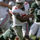 Ohio State quarterback Braxton Miller (5) avoids a tackle attempt by Michigan State safety Isaiah Lewis (9) during the first quarter of an NCAA college football game, Saturday, Sept. 29, 2012, in East Lansing, Mich. (AP Photo/Al Goldis)