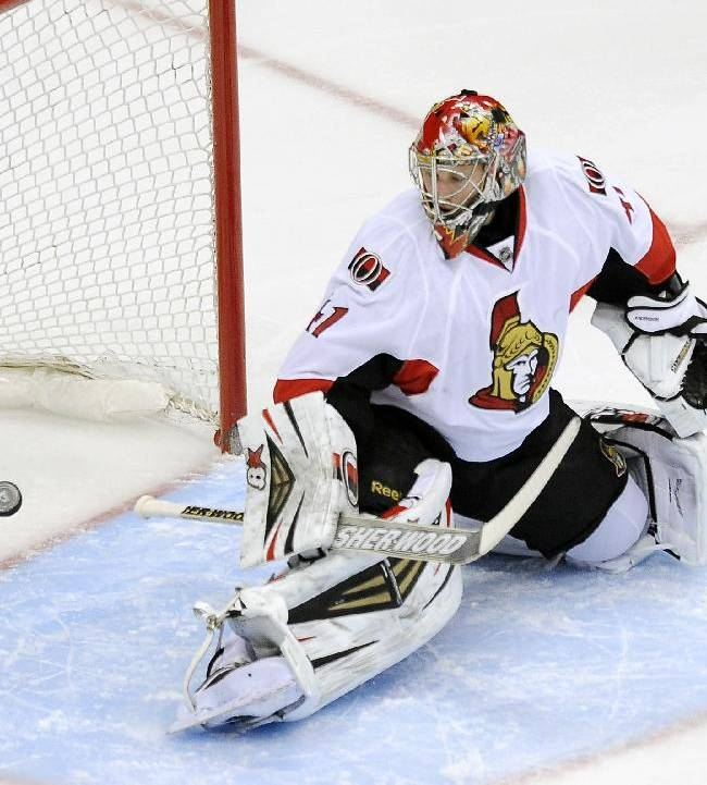 Ottawa Senators goalie Craig Anderson watches as the puck goes in the net on a goal by Colorado Avalanche left wing Jamie McGinn in the first period of an NHL hockey game on Wednesday, Jan. 8, 2014, in Denver