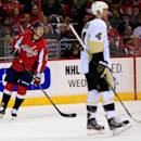 WASHINGTON, DC - MARCH 10: Evgeny Kuznetsov #92 of the Washington Capitals skates past Rob Scuderi #4 of the Pittsburgh Penguins during the first period at Verizon Center on March 10, 2014 in Washington, DC. (Photo by Rob Carr/Getty Images)