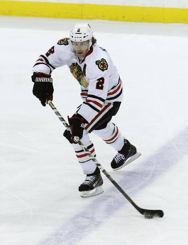 In this Dec. 5, 2013 file photo, Chicago Blackhawks defenseman Duncan Keith (2) controls the puck during the third period of an NHL hockey game against the Minnesota Wild in St. Paul, Minn. Duncan Keith leads all NHL defensemen with 30 assists