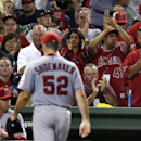 Los Angeles Angels starting pitcher Matt Shoemaker (52) gets a standing ovation from Angels fans as he is taken out of a baseball game after allowing one hit during the eighth inning against the Boston Red Sox at Fenway Park in Boston, Thursday, Aug. 21, 2014. (AP Photo/Charles Krupa)