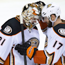 Anaheim Ducks goalie Frederik Andersen, left, of Denmark, is congratulated by Ryan Kesler after earning a shutout during the team's 4-0 win over the Vancouver Canucks in an NHL hockey game in Vancouver, British Columbia, on Tuesday, Jan. 27, 2015 The Asso