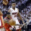 Chicago Bulls' Nate Robinson passes the ball as Miami Heat's Norris Cole (30) watches during the second half of Game 5 of an NBA basketball Eastern Conference semifinal, Wednesday, May 15, 2013, in Miami. (AP Photo/Wilfredo Lee)