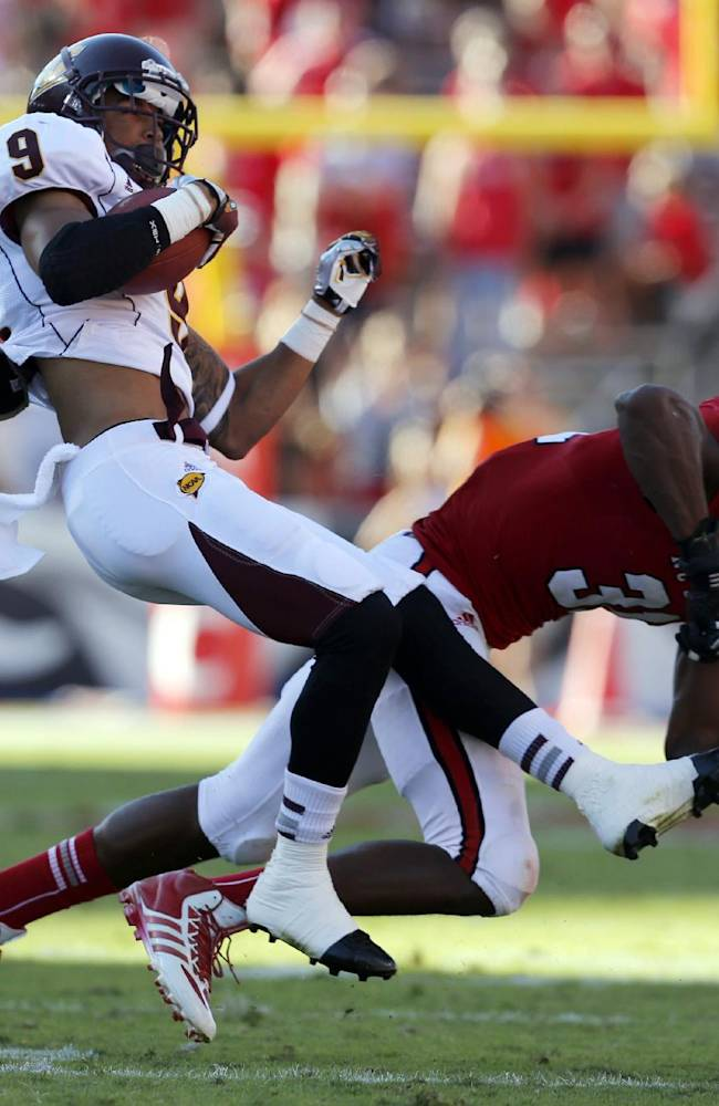 Central Michigan wide receiver Andrew Flory (9) is tackled by North Carolina State linebacker D.J. Green (31) during the first half of an NCAA college football game on Saturday, Sept. 28, 2013, at Carter-Finley Stadium in Raleigh, N.C