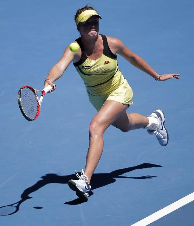 Elina Svitolina of Ukraine hits a forehand return to Olivia Rogowska of Australia during their second round match at the Australian Open tennis championship in Melbourne, Australia, Thursday, Jan. 16, 2014