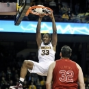 Minnesota's Rodney Williams Jr. (33) dunks of 2 of his team-high 23 points in front of Nebraska's Andre Almeida during the second half of an NCAA college basketball game, Tuesday, Jan. 29, 2013, in Minneapolis. Minnesota won 84-65. (AP Photo/Tom Olmscheid)