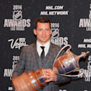 In this photo provided by the Las Vegas News Bureau, Andrew Ference of the Edmonton Oilers poses with the King Clancy Memorial Trophy for his humanitarian contributions to his community at the 2014 NHL Awards at Wynn Las Vegas. Tuesday, June 24, 2014 The