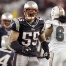 In this Dec. 23, 2007, file photo, New England Patriots linebacker Junior Seau (55) reacts after a defensive play during a football game against the Miami Dolphins in Foxborough, Mass. Super Bowl-winning quarterback Kurt Warner and linebacker Junior Seau